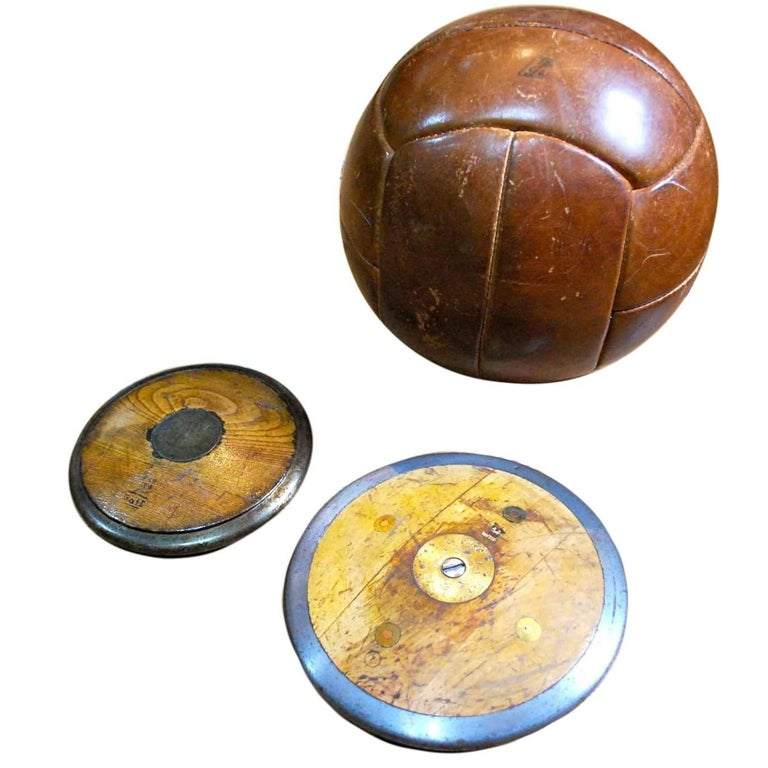 Antique Field Discus and Leather Medicine Ball