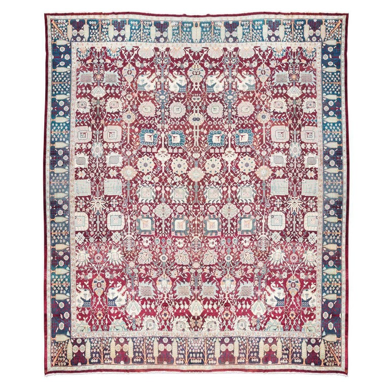 Antique rug circa 1880. Agra from India with Design of Natural Elements.