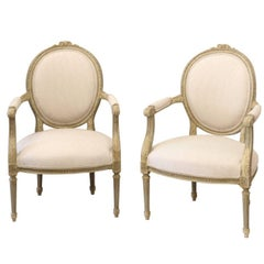 Pair of 1880s French Louis XVI Style Oval Back Painted and Carved Armchairs