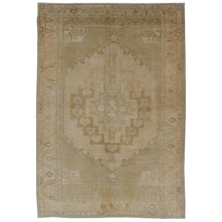 Faded Vintage Turkish Oushak Rug with Layered Medallion in Creams and Grays