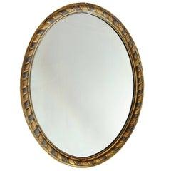 Irish George III Gold and Silver Leaf Oval Mirror, circa 1780