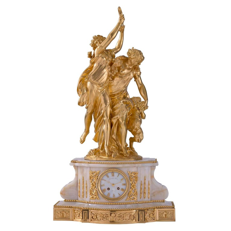French 19th Century Louis XVI Style Onyx and Ormolu Clock with Ormolu Sculpture