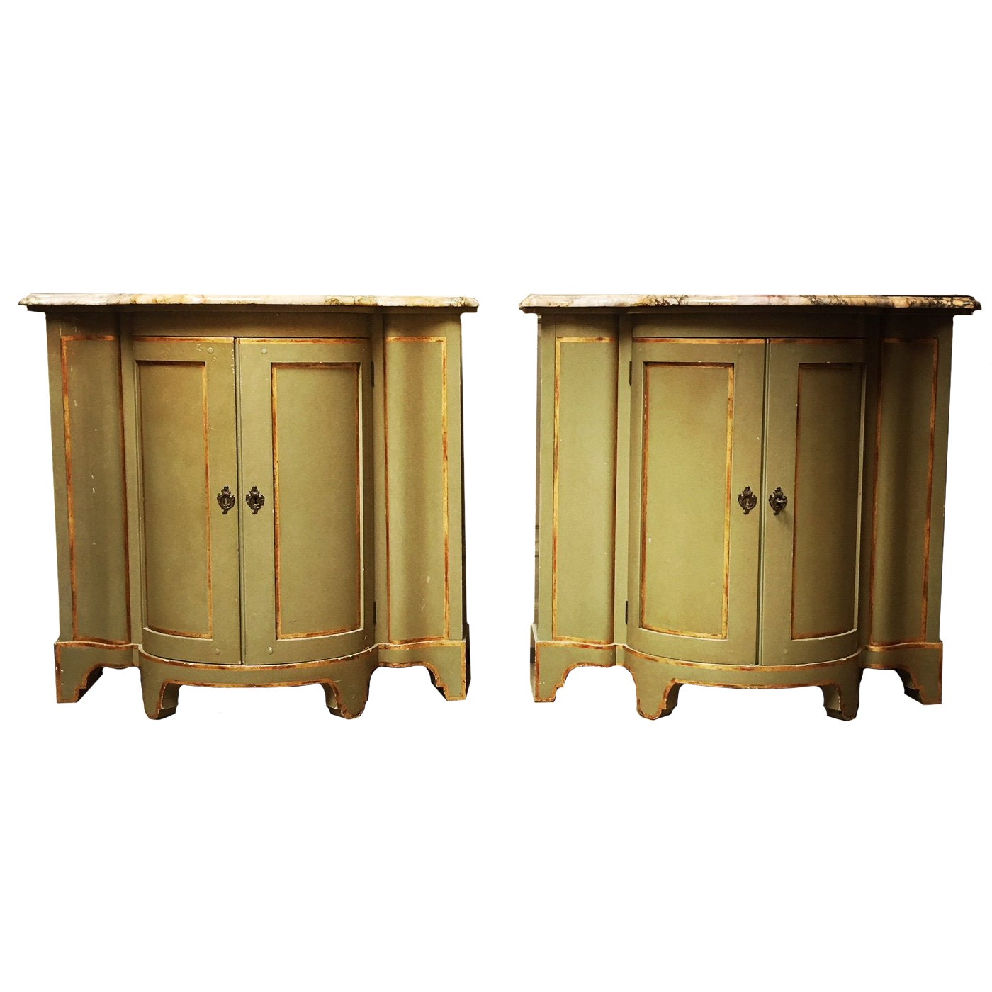 A Pair of Painted And Parcel Gilt Cabinets With Marble Tops