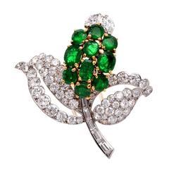 1960s Cartier Emerald Diamond Gold Platinum Floral Brooch