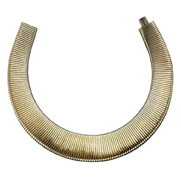 Expandable gold necklace