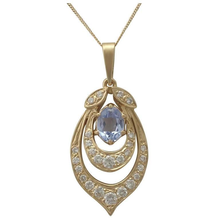 1980s 1.10 Carat Aquamarine and 0.92 Carat Diamond, Yellow Gold Pendant