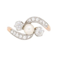 Edwardian Pearl and Diamond Three-Stone Twist Ring, circa 1910