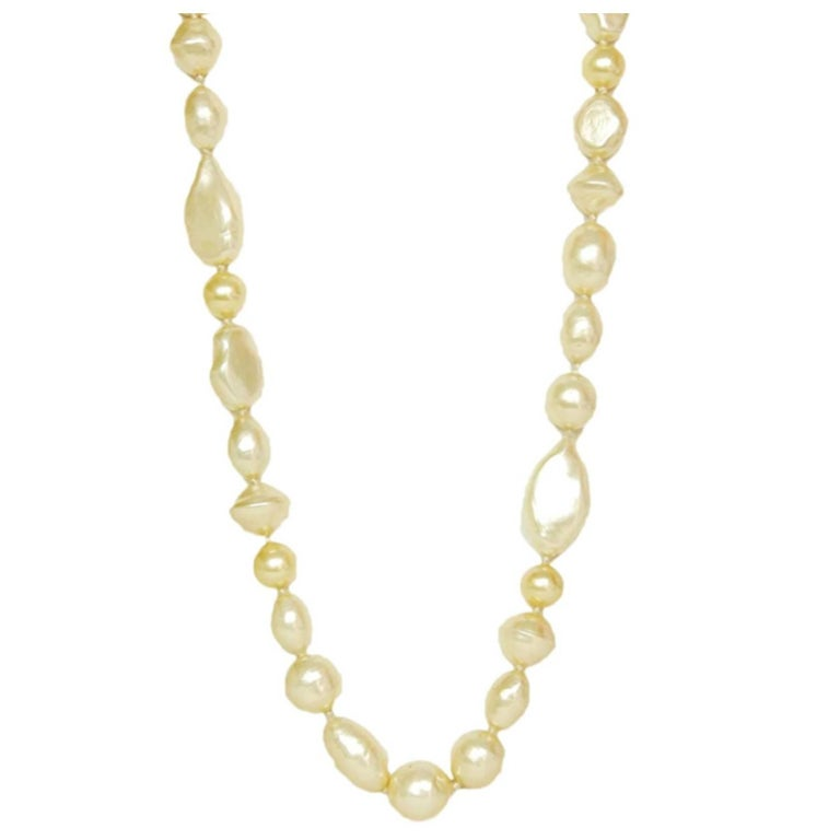 Chanel 1983 Vintage Long Multishape Faux Pearl Necklace Gripoix Closure  For Sale