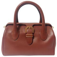 Vintage Valentino Garavani, brick brown leather mini handbag with golden logo