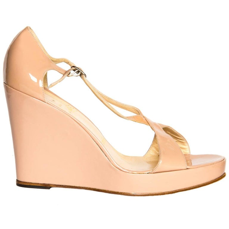 low priced af0fd fbb15 Christian Louboutin Nude Patent Leather Wedges