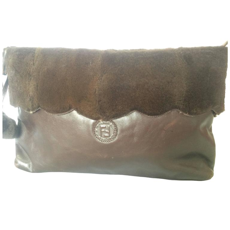 Vintage FENDI dark brown large leather clutch bag with rabbit fur and pom pom.