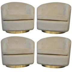 Set of Four Milo Baughman Swivel Chairs on Brass Bases