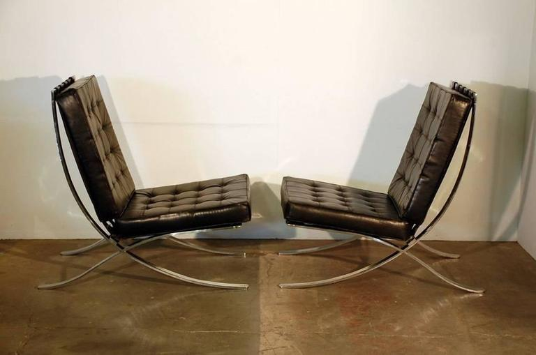Pair of oversized French 1970s Barcelona style chairs. Not the typical Mies van der Rohe copy; a reinterpretation of the design from the 1970s. Purchased in Paris at Artcurial auction house. Measures: Seat slopes down from 18 to 14 in height.