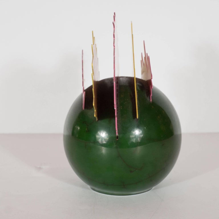 This idiosyncratic and powerful sculpture, with its vibrant color scheme and dynamic form, encapsulates all of the energy of pop on an intimate scale. The enamel green base with black veins (fabricated to resemble marble) evokes a cartoonish bomb,