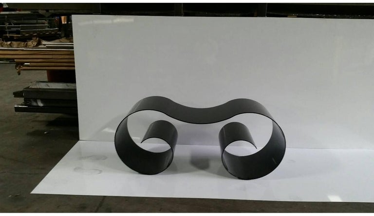 It's inspired by the capital of an ionic column. Instead of the look of dense stone, I wanted to extract the lines of the form to create a light, spacious and resilient bench in which a person sits in the middle, framed on either side by two big