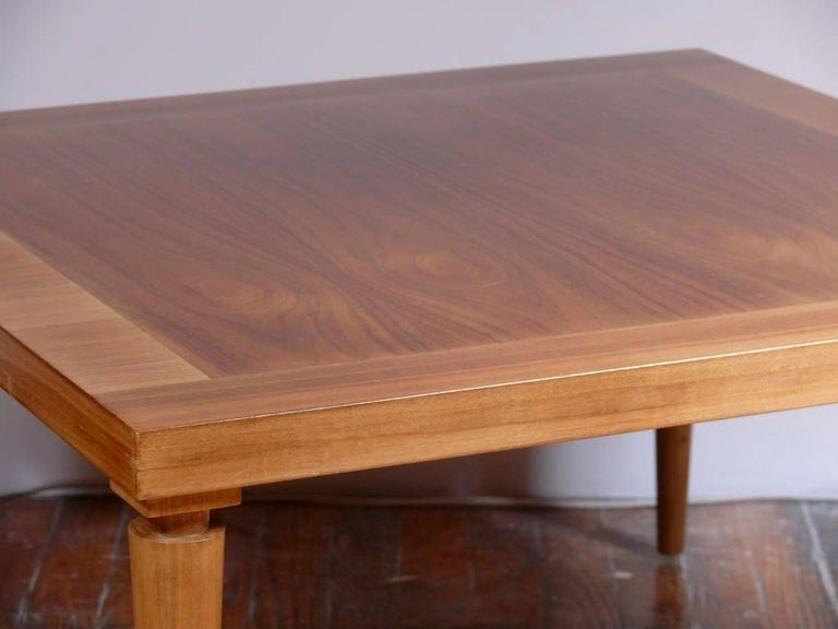 Cocktail table byT.H. Robsjohn-Gibbings for Widdicomb. Signed and labeled. Finished in a natural walnut with banded edge and neoclassic legs.