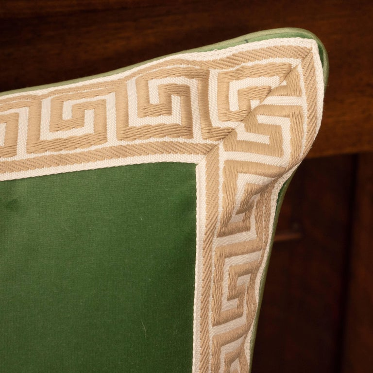 A pair of green velvet pillows with Greek key.