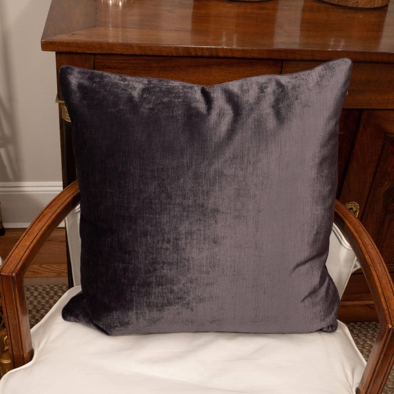 Deep purple velvet cushions with cording.