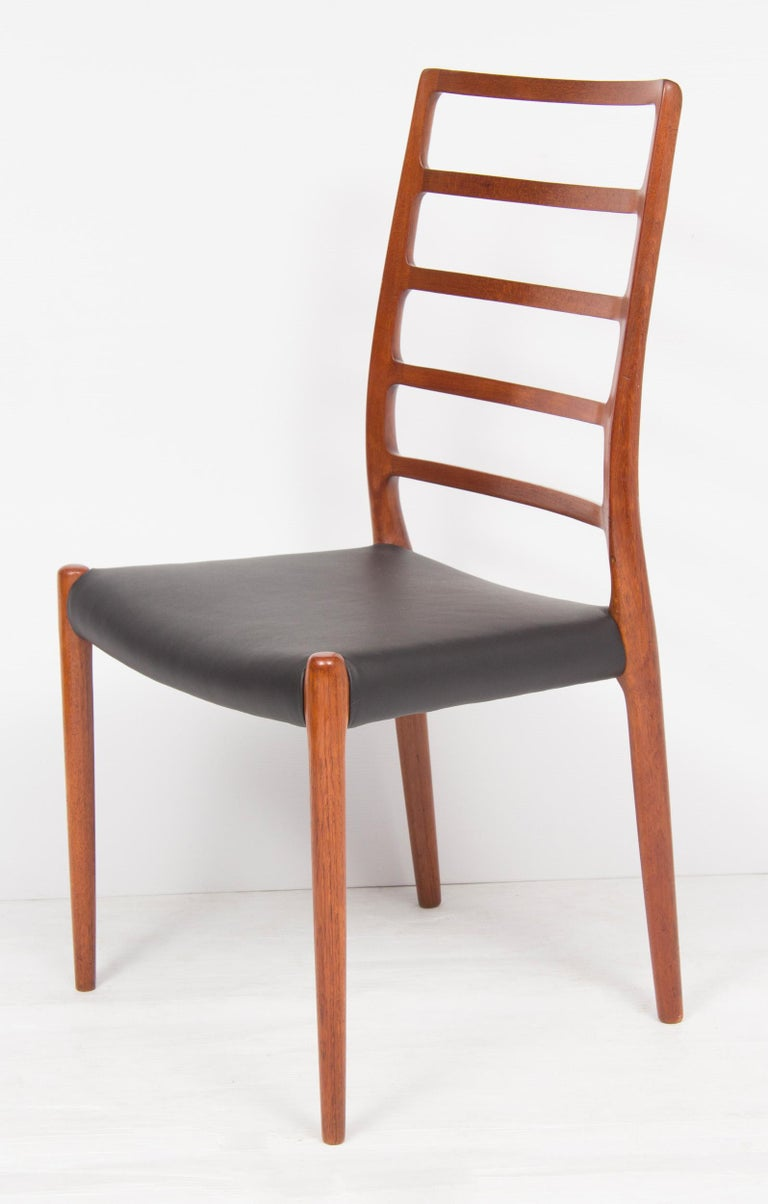 Mid-Century Modern Set of Four Neils O.Moller Model 82 Teak Ladder Back Dining Chairs For Sale