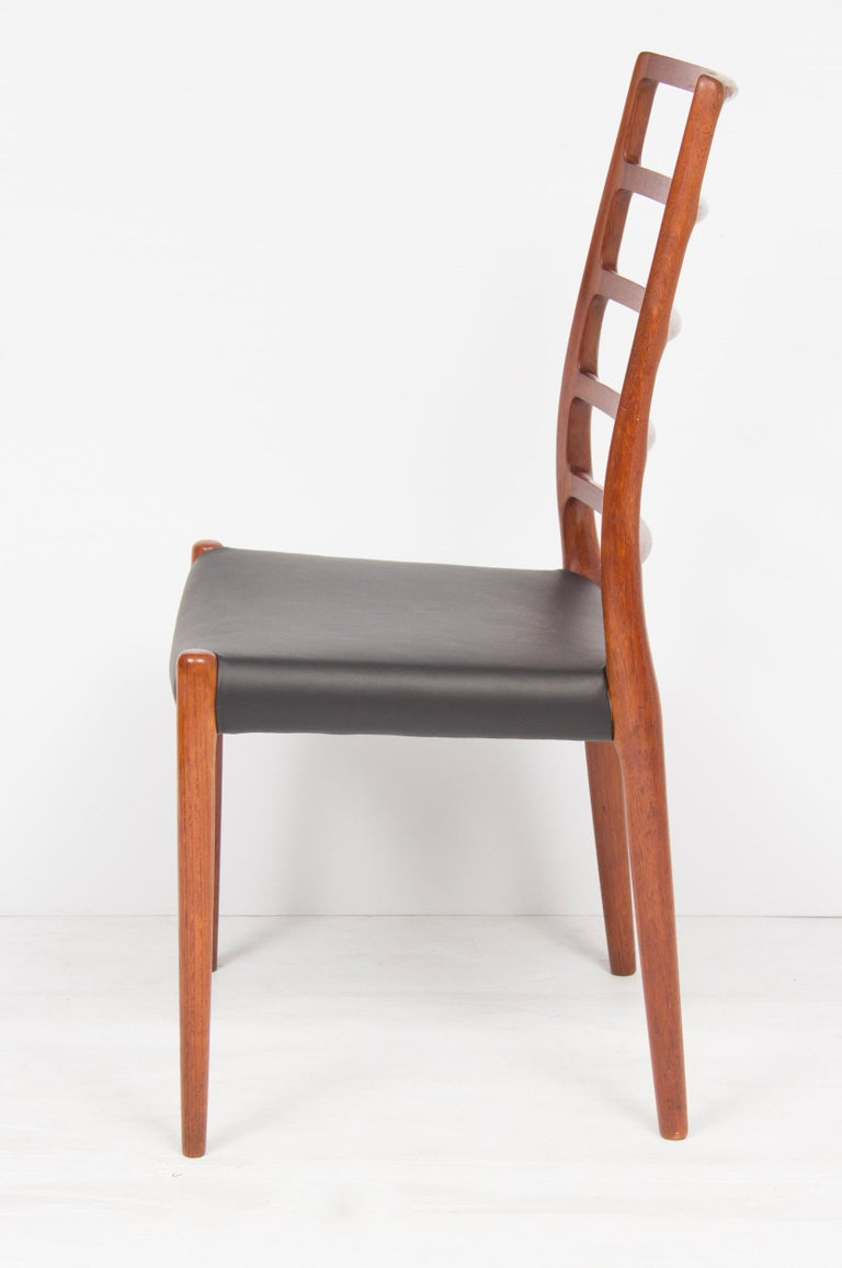Danish Set of Four Neils O.Moller Model 82 Teak Ladder Back Dining Chairs For Sale