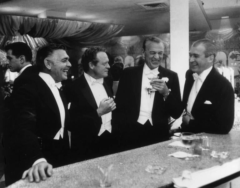 Slim Aarons Black and White Photograph - Kings of Hollywood (New Year's at Romanoff's)