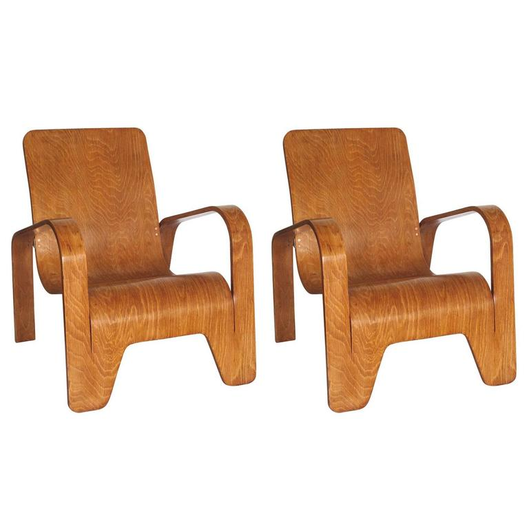 Offerd by Zitzo, Amsterdam: Ingenious design that utilizes a single piece of plywood to create the arms, legs, and seat of the chair. These lounge chairs are stackable. Approximately production of 1300 chairs, each chair is numbered.  Literature: