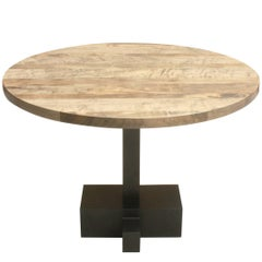 Juno, an Oxidized Maple and Ebonized Oak Pedestal Table with Blackened Steel