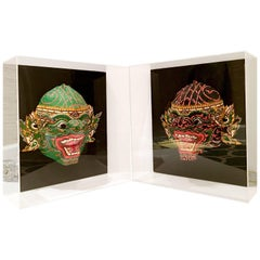 Pair of 20th Century Lucite Shadow Box Mounted Hand-Painted Tribal Masks
