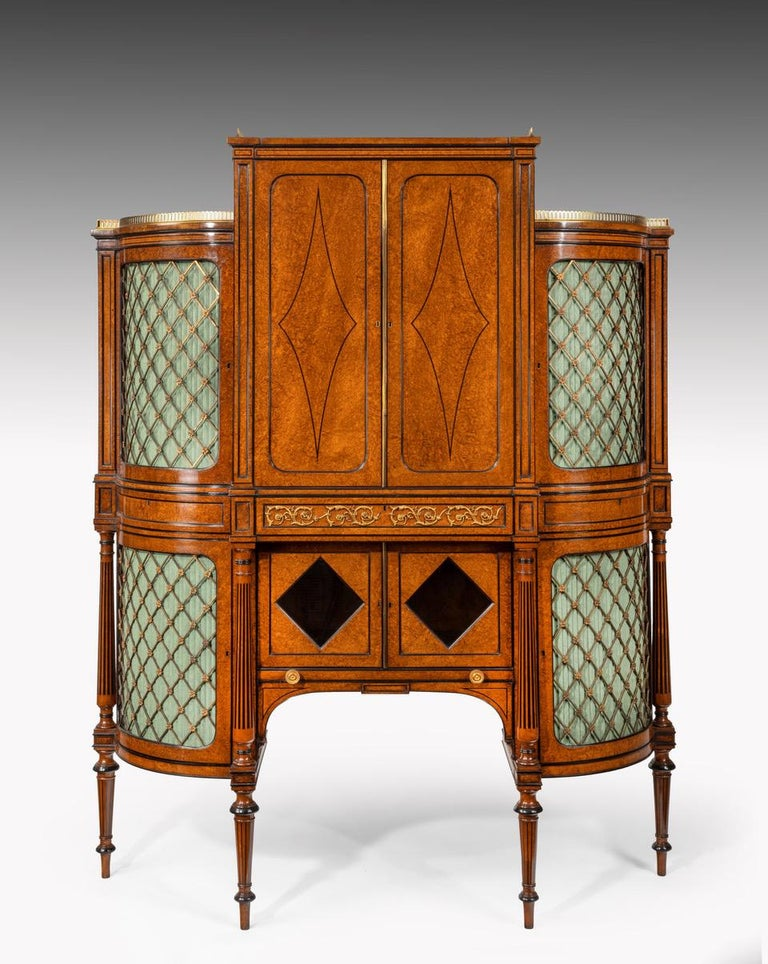 An exhibition quality 19th century ormolu-mounted amboyna and ebony shaped side cabinet on tapering legs, circa 1860.
