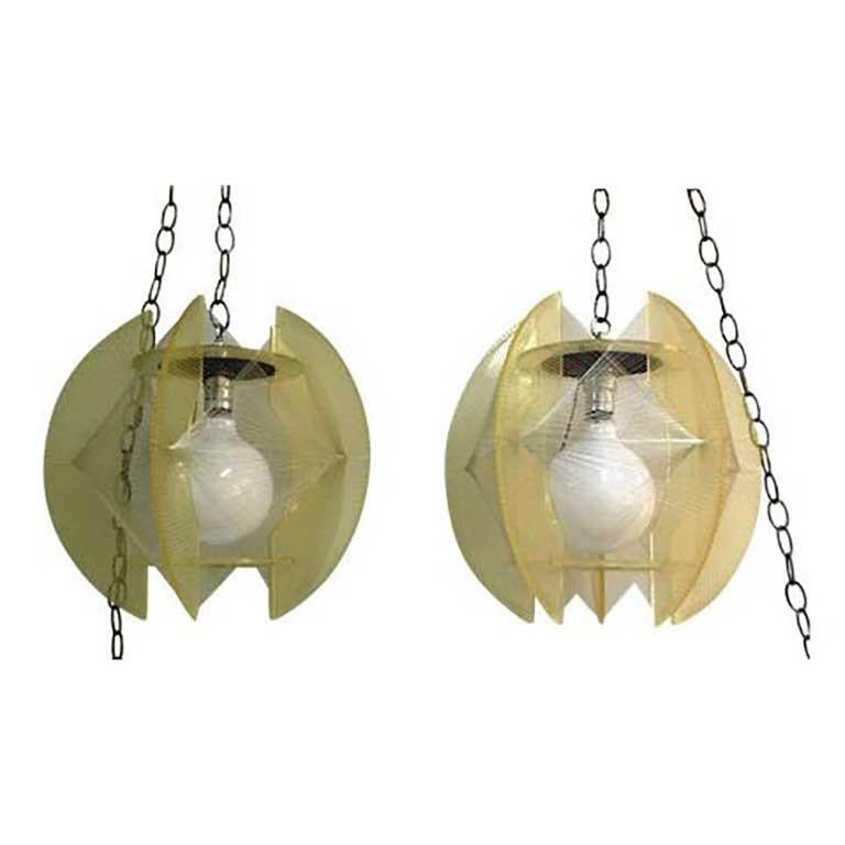 Mid century round form string and lucite hanging light fixture at pair of mid century modern lucite and string hanging chain pendant lamps aloadofball Image collections