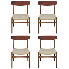 Set of Four Modern Hans Wegner Teak and Woven Cord Dining Chairs Model CH23