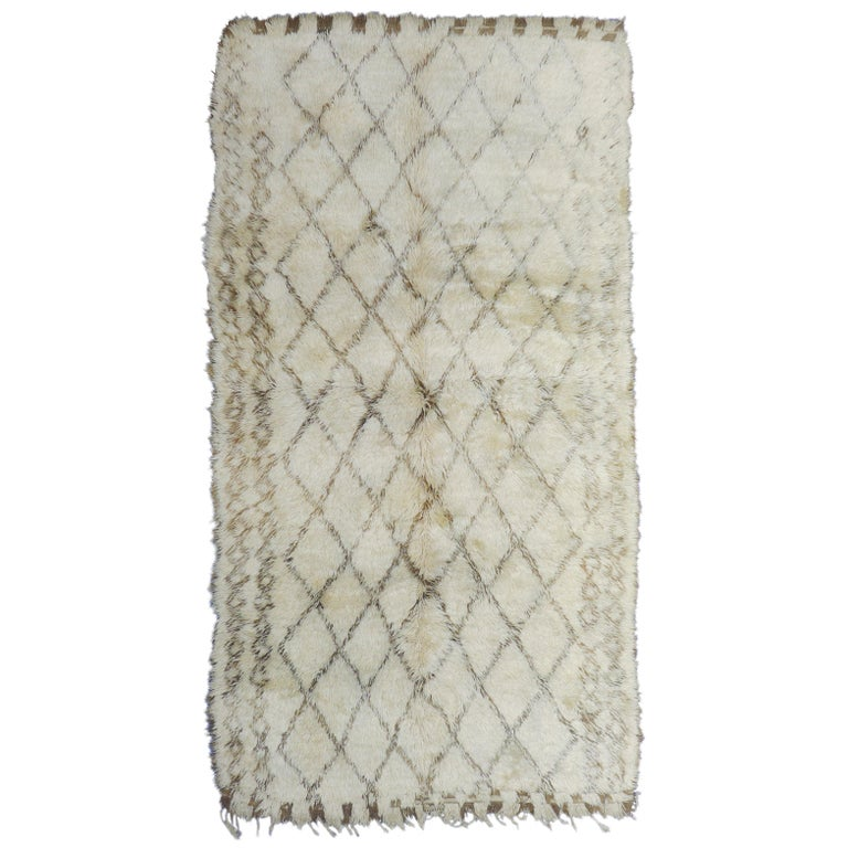 Vintage Moroccan Berber Rug with a Natural Ivory Wool and Olive Color Accent For Sale