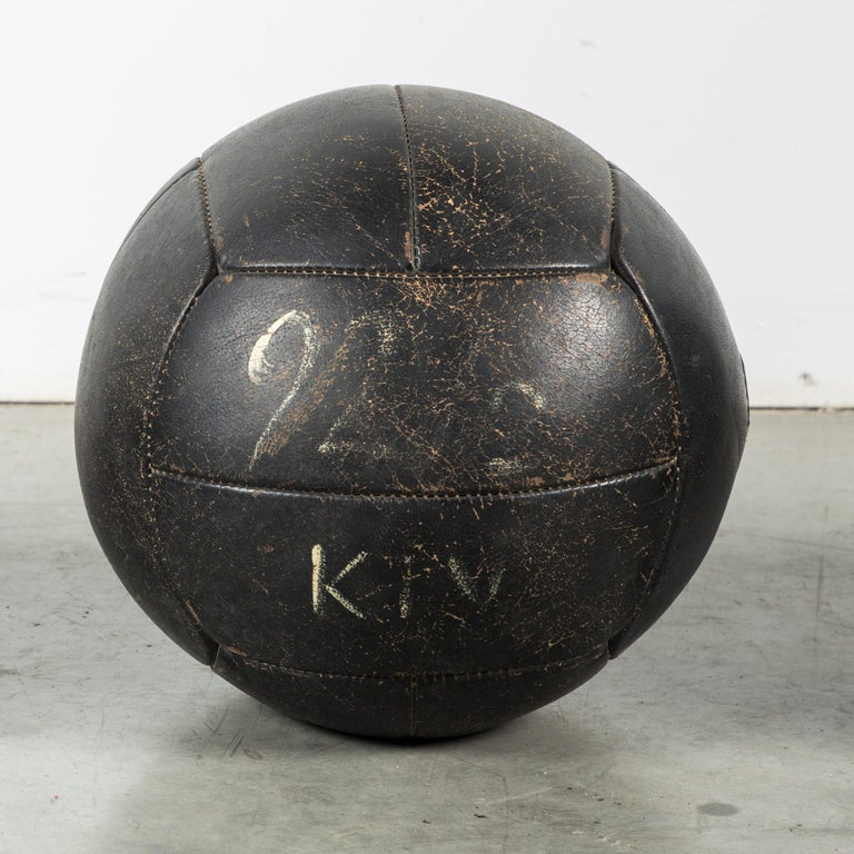 Great vintage collection of three black leather medicine balls. Excellent warm vintage patina. Traces of white painted team letters and numbers.