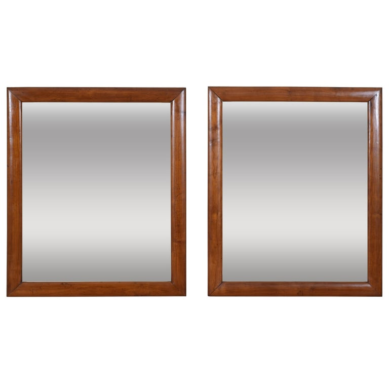 Pair of Italian Neoclassical Period Solid Walnut Mirrors