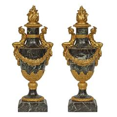 Pair of French 19th Century Neoclassical, Solid Lavanto Rouge Marble Urns