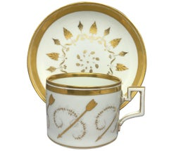 Cupid's Arrow Gilt Porcelain Cup and Saucer