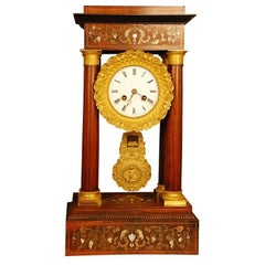 Portico Clock in Tulipwood with Fine Inlay and Ormolu Mounts-France, 19th c.