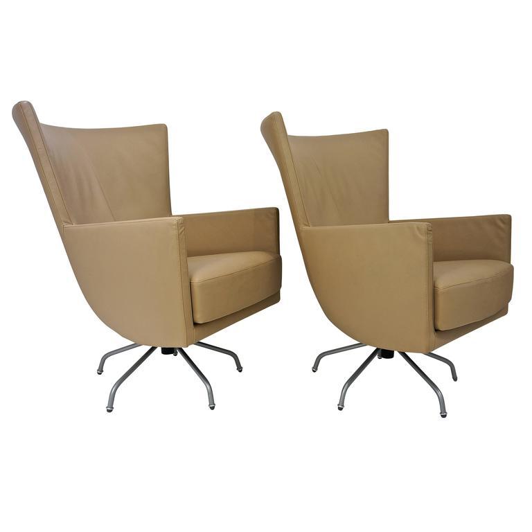 Pair Of Modern Italian Swivel Lounge Chairs Upholstered