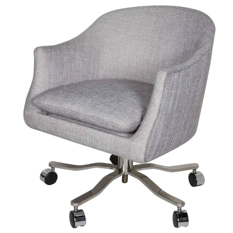 Mid-century desk chair with barrel back form. Elegant seamless shape that can swivel 360° and the height of the seat can be adjusted via the corkscrew centre rod. Upholstered in an elegant light grey woven fabric, with removable seat cushion. The