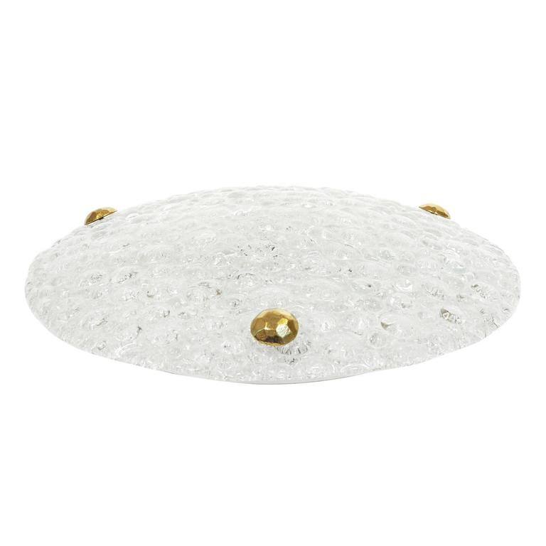 Excellent flush mount by Hillebrand with beautiful thick bubble-textured glass. Three large sculpted brass knobs affix the glass to a white lacquered back plate which holds three E14 ceramic sockets as well as a manufacturers label. Would also make