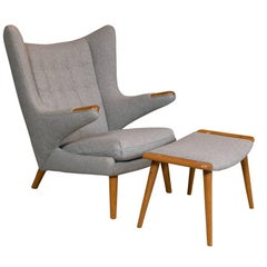 A Hans Wegner Papa Bear Chair with Stool produced by A.P. Stolen