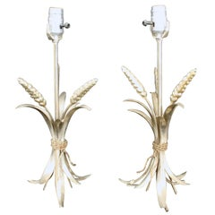 Two metal lamps with a bunch of wheat at base and new shade.