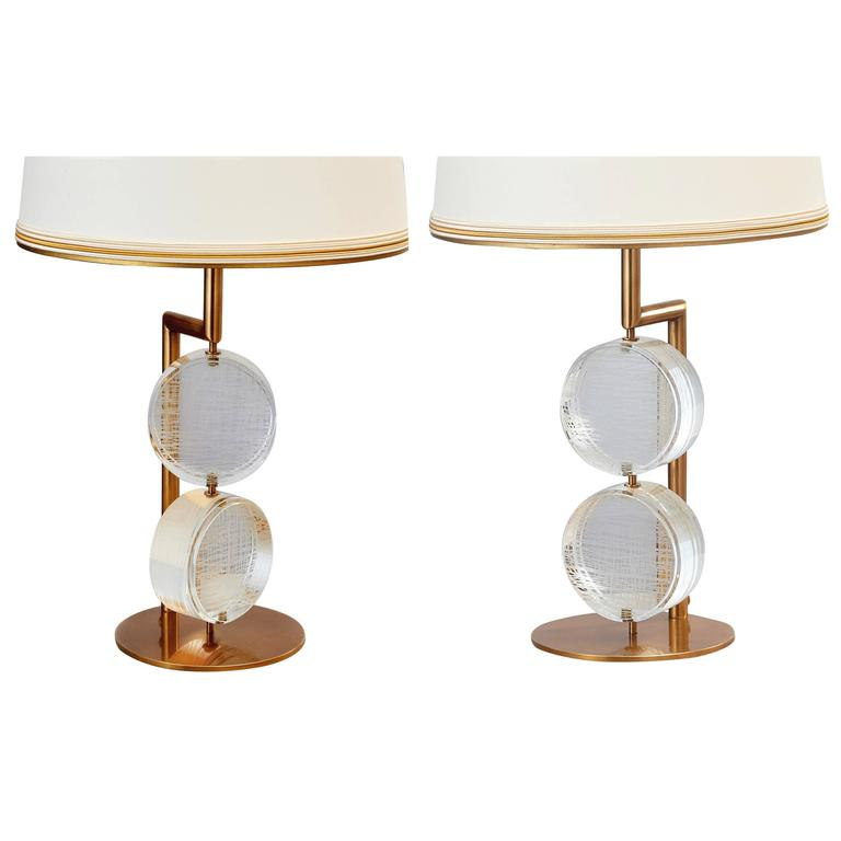 Roberto Rida (b.1943). A kinetic pair of elongated table lamps with thick, movable, etched glass disks, bronze mounts. Signed,  Italy, 2017. Priced by the pair, three pair availble Dimensions: 30 H x 12 diameter. Limited edition exclusive to L'Art