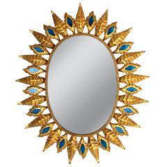 Spanish 1960s Hollywood Regency Gilt Iron Sunburst Oval Mirror with Blue Glasses