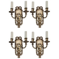 Elegant Pair of E.F. Caldwell Silvered Bronze Two-Arm Neoclassical Bow Sconces
