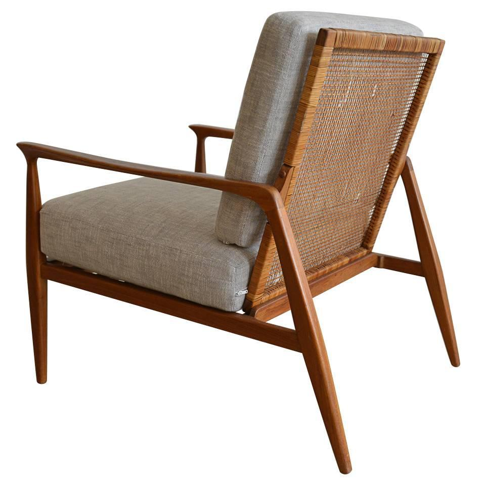 Danish cane back lounge chair in the manner of kofod larsen at 1stdibs