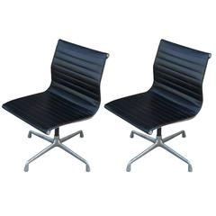 Two Eames Aluminum Group Chairs