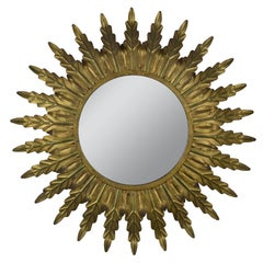 Gilt Metal Sunburst Mirror with Radiating Leaves and Traces of Green Hues