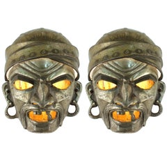 Pair of 1930s Wall Sconces as Grotesque Masks in Cast Metal