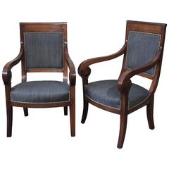 Pair of French Restauration Period Walnut Fauteuils with Scroll Arms